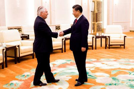 China's President Xi Jinping shakes hands with U.S. State of Secretary, Rex Tillerson at the Great Hall of the People in Beijing