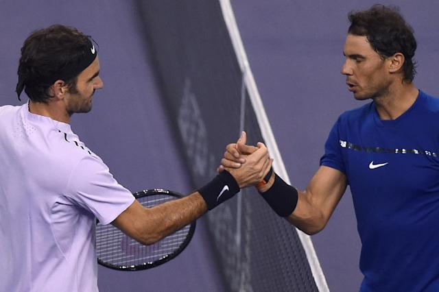 Roger Federer (L) and Rafael Nadal are the leading contenders for the Tour Finals trophy (AFP Photo/Chandan KHANNA)