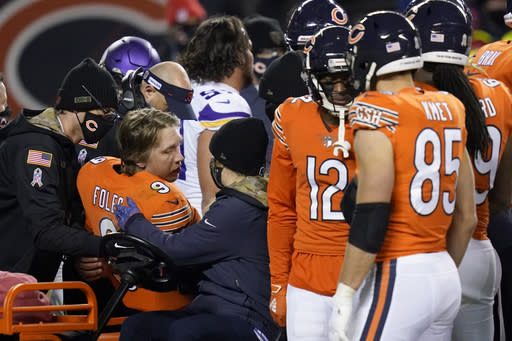 Chicago Bears quarterback Nick Foles is taken off on a cart after being injured during the second half of an NFL football game against the Minnesota Vikings Monday, Nov. 16, 2020, in Chicago. (AP Photo/Charles Rex Arbogast)