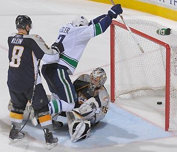 The puck touched Ryan Kesler on its way past Predators goalie Pekka Rinne for the overtime game-winner