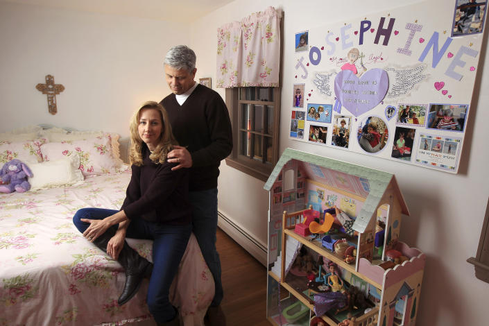 "Bob and Michele Gay, who lost a child in the Sandy Hook Elementary School shooting, in a room in their new home in Boston, Dec. 3, 2013. They re-created the bedroom of their daughter Josephine, or ""Joey."" (Photo: Essdras M. Suarez/The Boston Globe via Getty Images)"