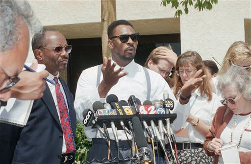 This June 2, 1994 file photo shows Rodney King speaking at a news conference in Santa Ana, Calif. along with his attorney Milton Grimes, at left. King, the black motorist whose 1991 videotaped beating by Los Angeles police officers was the touchstone for one of the most destructive race riots in the nation's history, has died, his publicist said Sunday, June 17, 2012. He was 47. (AP Photo/Chris Martinez, file)