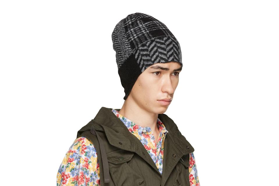 "$100, SSENSE. <a href=""https://www.ssense.com/en-us/men/product/engineered-garments/black-and-grey-patchwork-beanie/6849411"" rel=""nofollow noopener"" target=""_blank"" data-ylk=""slk:Get it now!"" class=""link rapid-noclick-resp"">Get it now!</a>"
