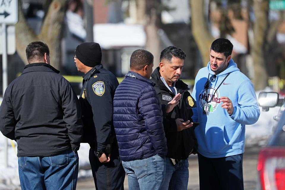 Milwaukee Police Chief Alfonso Morales, second from right, works with investigating officers on the scene where three bodies were found. The investigation seemed to center on an alley behind a building in the 4700 block of West Burleigh Street.