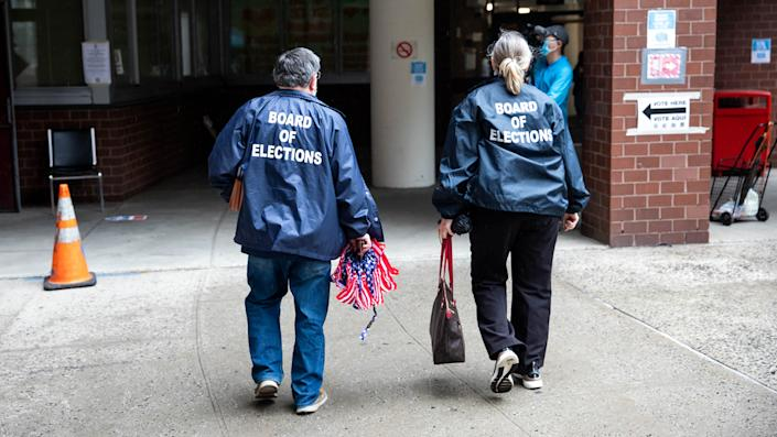 Board of Elections workers arrive at a polling site in Chinatown, Manhattan, for the New York City mayoral primary election on June 22, 2021.