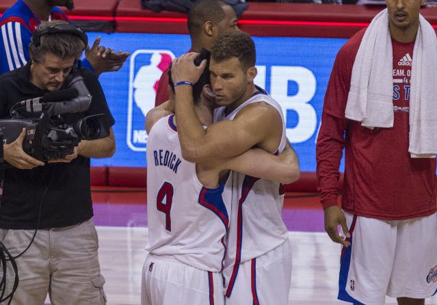 Los Angeles Clippers forward Blake Griffin (32) hugs with his teammate J.J. Redick (4) after defeating Golden State Warriors during the second half of Game 7 of a first-round NBA basketball playoff series, Saturday, May 3, 2014, in Los Angeles. Clippers won 126 - 121. (AP Photo/Ringo H.W. Chiu)