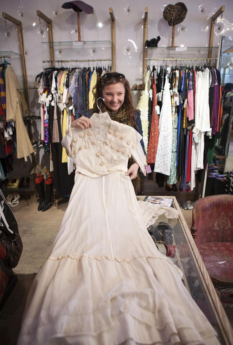 """In this photo taken Thursday, Feb. 21, 2013, Anna Ovdienko looks for a vintage Edwardian era dress at """"The Way We Wore,"""" a Hollywood high-end vintage store owned by Doris Raymond in the La Brea District of Los Angeles. Raymond's vintage clothing and accessories store is featured in the reality TV series, """"L.A. Frock Stars,"""" which debuts March 7, 2013 on the Smithsonian Channel. (AP Photo/Damian Dovarganes)"""