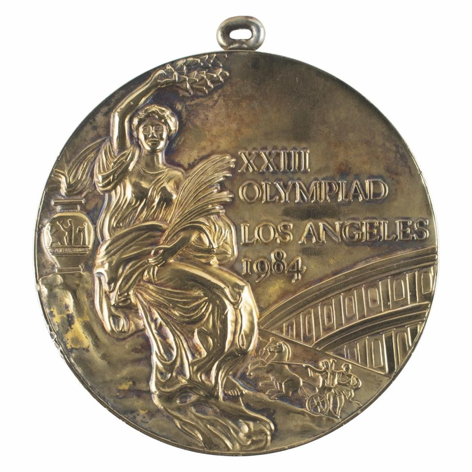 In this photo provided by RR Auction of Boston, an Olympic gold medal from the Los Angeles 1984 Olympic Games is shown. Olympic medals dating to 1896, relay torches from several eras, and other Olympic memorabilia are among the items being auctioned by RR Auction, just 10 days before the start of the Tokyo games. (Nikki Brickett/RR Auction via AP)