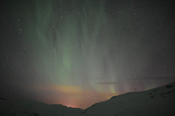 """Colorful auroras shimmer over northern Sweden on Feb. 21, 2014 in this image from the video """"Lights Over Lapland"""" by Chad Blakley."""