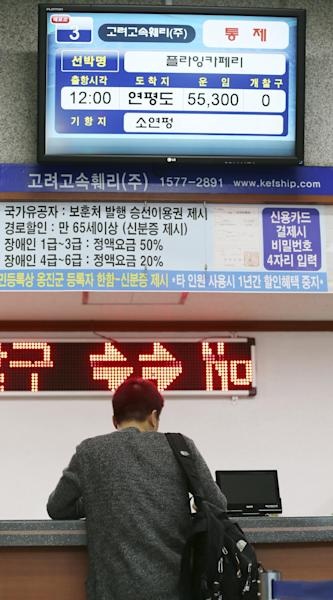 A passenger gets a refund of his ticket for Yeonpyeong island in the western sea at Incheon port passenger terminal in Incheon, west of Seoul, South Korea, Tuesday, April 29, 2014. North Korea notified rival South Korea on Tuesday that it planned a live-fire drill near the countries' disputed western sea boundary, a possible indication of rising frustration in Pyongyang as it unsuccessfully pushes for outside aid. (AP Photo/Yonhap, Yun Tae-hyun) KOREA OUT