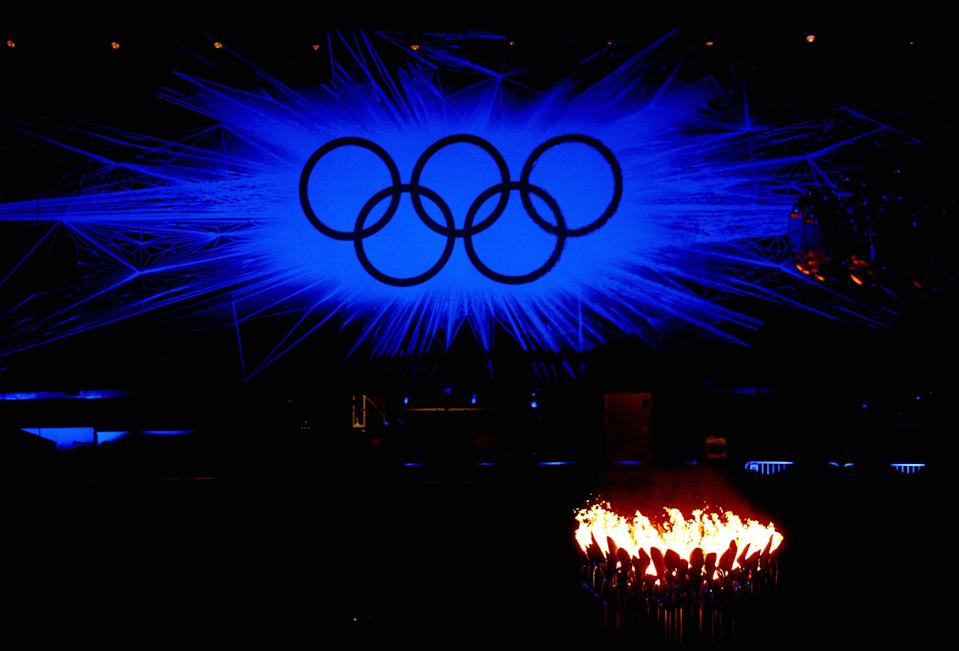 The Olympic Cauldron burns in front of the Olympic rings during the Closing Ceremony on Day 16 of the London 2012 Olympic Games at Olympic Stadium on August 12, 2012 in London, England. (Photo by Feng Li/Getty Images)