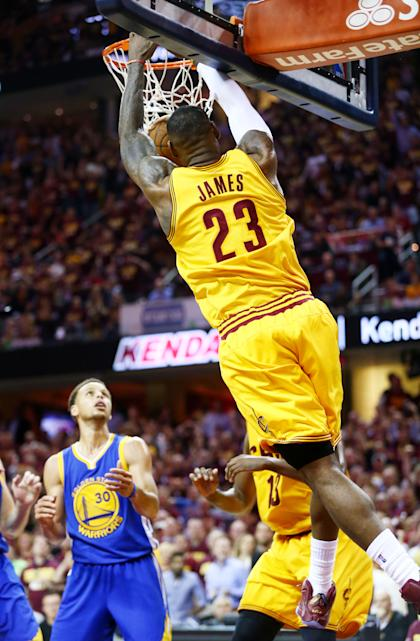CLEVELAND, OH - JUNE 11: LeBron James #23 of the Cleveland Cavaliers dunks against Stephen Curry #30 of the Golden State Warriors in the third quarter during Game Four of the 2015 NBA Finals at Quicken Loans Arena on June 11, 2015 in Cleveland, Ohio. (Photo by Ronald Martinez/Getty Images)
