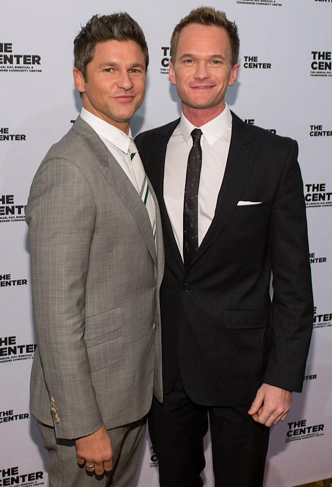 """A chance encounter on a New York City sidewalk in 2004 led to sparks between Neil Patrick Harris and David Burtka. """"We met on Ninth Avenue between 44th and 45th, through a friend of ours. That was it,"""" the """"How I Met Your Mother"""" star, 40, told New York magazine in 2010. Now the parents of 2-year-old twins Harper and Gideon, the couple has long been engaged — Burtka, 38, popped the question on the street corner where they met! — but they have been waiting to make it official in California. But don't expect them to run down the aisle right away. """"We contemplated getting married in California before the Prop 8 debacle, and I opted not to immediately because I didn't want it to be a media event. I didn't want to go marching down the street with camera crews. Oy. To get married? Really? It seems like you have an agenda when you do it that way,"""" he told Details in 2011. """"I wouldn't want to get married to be an example."""""""