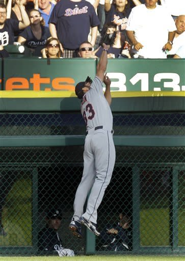 Cleveland Indians left fielder Johnny Damon (33) robs Detroit Tigers' Prince Fielder of a home run during the second inning of a baseball game in Detroit, Wednesday, June 6, 2012. (AP Photo/Carlos Osorio)