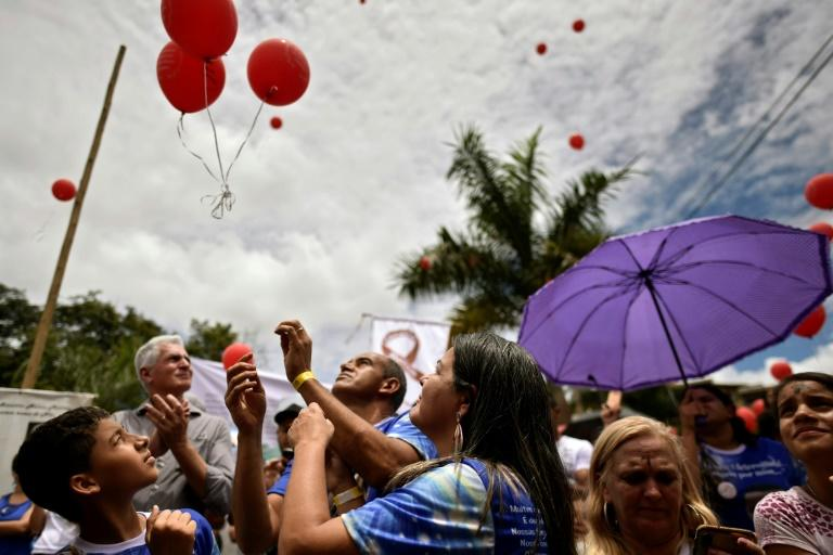 Mourners in Brumadinho, Brazil released red balloons on January 25, 2020 in memory of the 270 people killed following a massive dam breach (AFP Photo/DOUGLAS MAGNO)