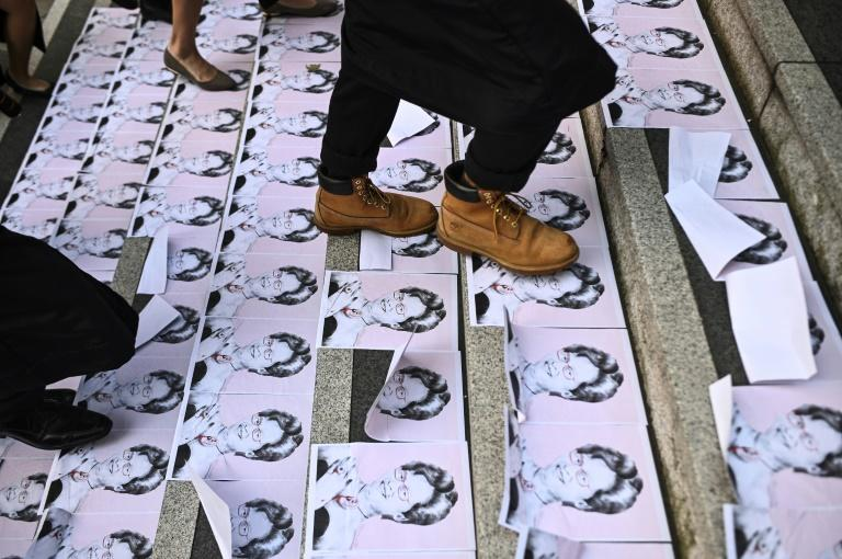 University students trample pictures of Hong Kong's pro-Chinese leader Carrie Lam at a pre-graduation demo at the Chinese University of Hong Kong (AFP Photo/Philip FONG)