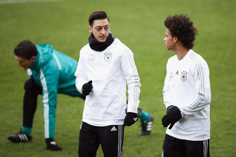 Ozil speaks with Manchester City's Leroy Sane in Germany training: Bongarts/Getty Images