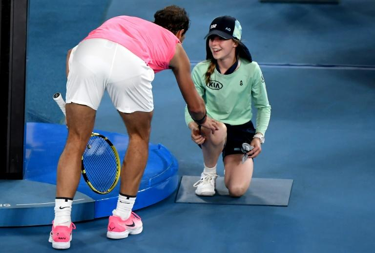 Spain's Rafael Nadal consoles a ballgirl he hit with a shot