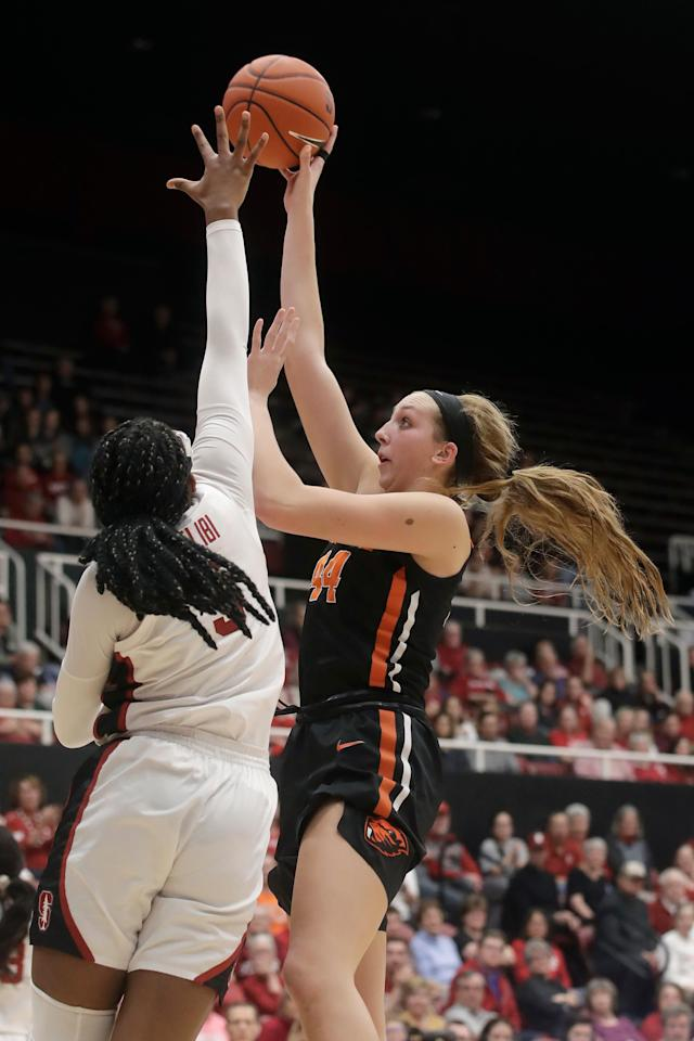 Oregon State forward Taylor Jones, right, shoots against Stanford forward Francesca Belibi during the second half of an NCAA college basketball game in Stanford, Calif., Friday, Feb. 21, 2020. (AP Photo/Jeff Chiu)