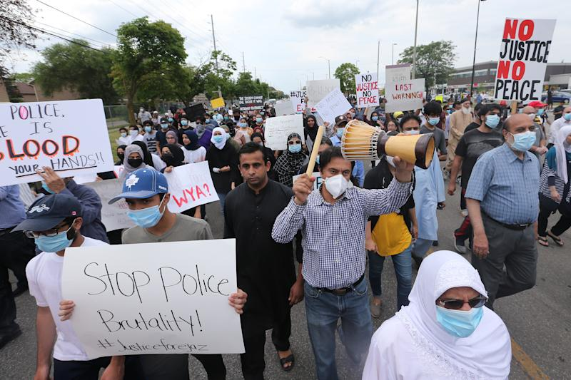 MISSISSAUGA, ON- JUNE 22 - Protesters continue to rally outside the Malton apartment building where 62-year-old Ejaz Choudry was fatally shot by Peel police officers Saturday following a 911 call for a mental-health crisis. in . June 22, 2020. (Steve Russell/Toronto Star via Getty Images)