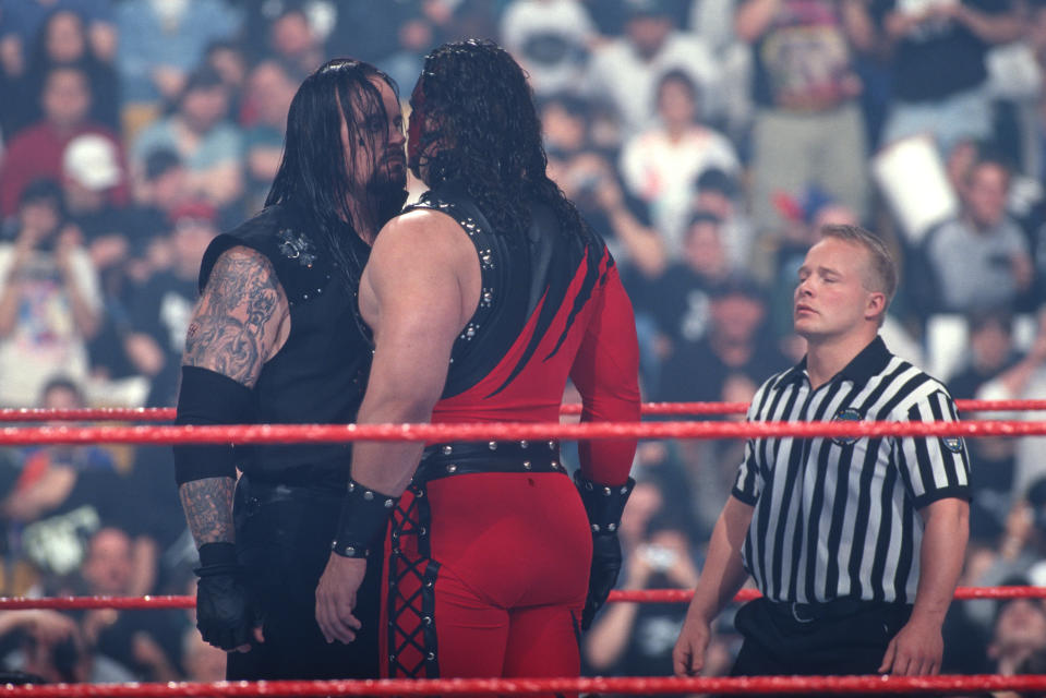 Kane and the Undertaker are seen during the one of their earliest feuds in the 1990. (Photo courtesy of WWE)