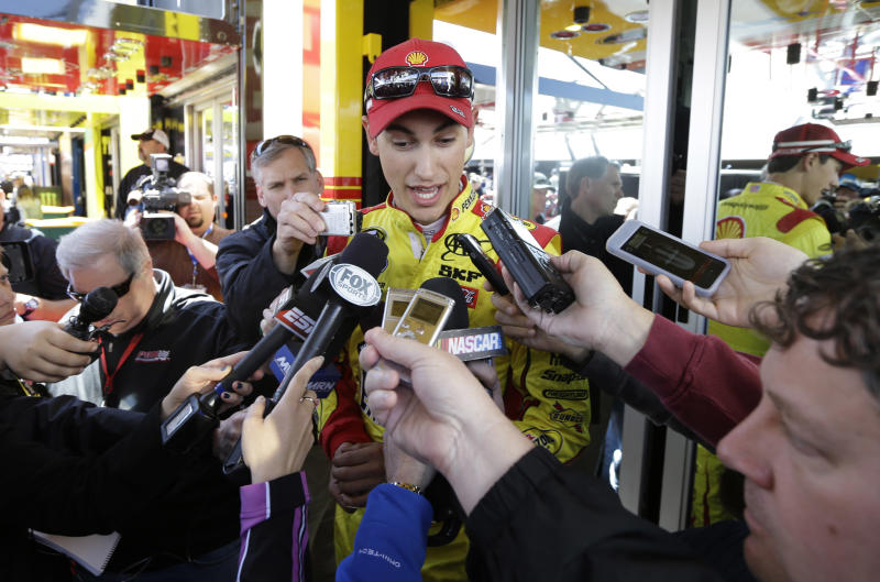Driver Joey Logano speaks with the media after practice for Sunday's NASCAR Sprint Cup Series auto race at Martinsville Speedway in Martinsville, Va., Friday, April 5, 2013. (AP Photo/Steve Helber)