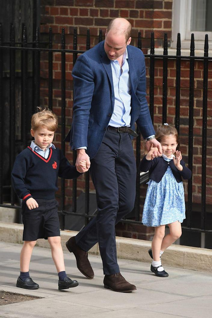 """<p><a href=""""https://www.townandcountrymag.com/society/tradition/g19723493/prince-george-princess-charlotte-royal-baby-3-photos-lindo-wing/"""" rel=""""nofollow noopener"""" target=""""_blank"""" data-ylk=""""slk:Prince George arrives at St. Mary's Hospital"""" class=""""link rapid-noclick-resp"""">Prince George arrives at St. Mary's Hospital</a> in London with dad Prince William and Princess Charlotte to meet his newborn brother! The little royal was in his school uniform. </p>"""