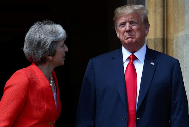 <p>Britain's Prime Minister Theresa May poses for a photograph with President Donald Trump at Chequers near Aylesbury, Britain, July 13, 2018. (Photo: Hannah McKay/Reuters) </p>