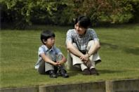 FILE PHOTO: Japan's Prince Hisahito and his father Prince Akishino talk as they sit on the grounds of the Akasaka Detached Palace in Tokyo