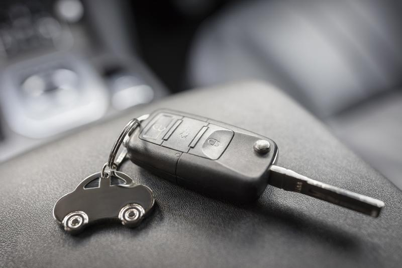 Car key sitting on top of a car's center console.