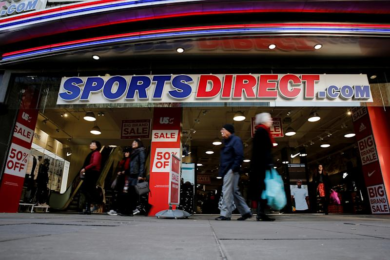Shoppers walk past Sports Direct store on Oxford Street in London, Britain December 17, 2018. REUTERS/Simon Dawson