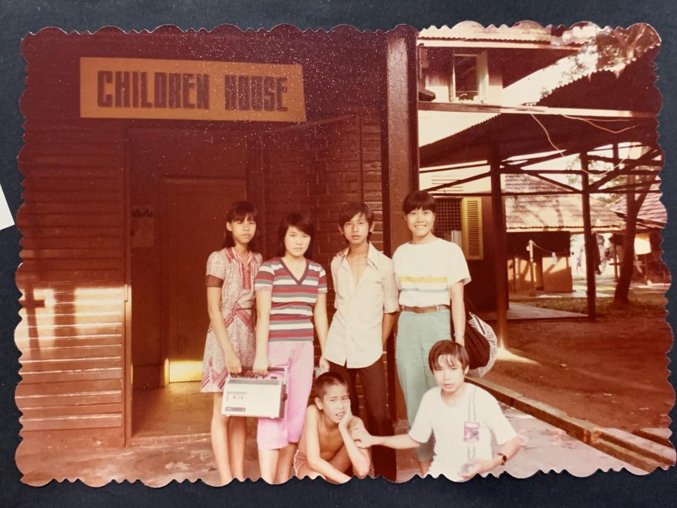 Alvina Khoo (right), aged 21 at the time, with some of her students at the Vietnamese refugee camp in Hawkins Road, Sembawang in Singapore, 1985. PHOTO: Alvina Khoo