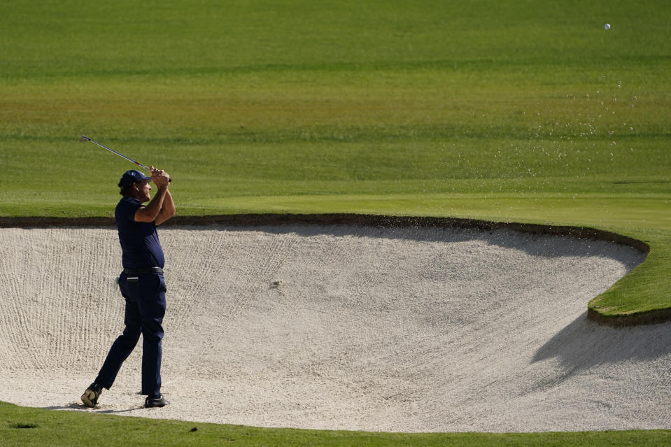 Phil Mickelson hits out of a bunker on the second hole during the third round of the Masters golf tournament Saturday, Nov. 14, 2020, in Augusta, Ga. (AP Photo/Matt Slocum)