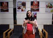 Entrepreneur Narges Aziz Shahi possess for a photo at her cafŽ in Kabul