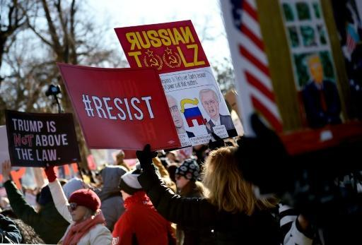 Pro-impeachment protesters carried a variety of signs critical of US President Donald Trump