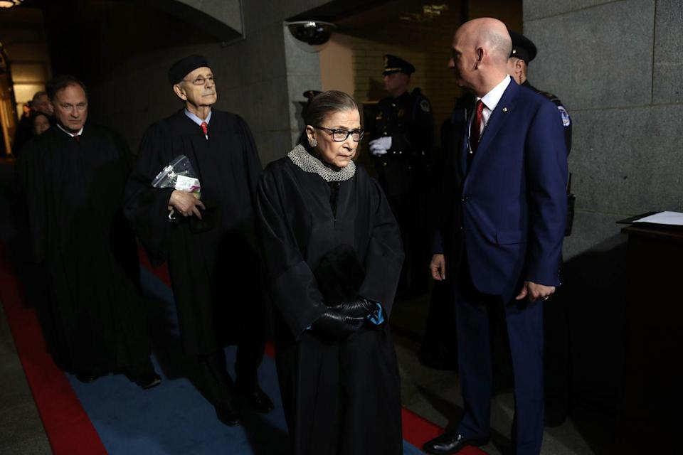 "<p>Supreme Court Justices Samuel Alito (left), Ginsburg (in her ""dissenting"" collar) and Stephen Breyer (center) arrive at the U.S. Capitol to watch Trump as he was sworn in as president. </p><p>Before the 2016 election, <a href=""https://www.cnn.com/2016/07/12/politics/justice-ruth-bader-ginsburg-donald-trump-faker/index.html"" rel=""nofollow noopener"" target=""_blank"" data-ylk=""slk:Ginsburg said"" class=""link rapid-noclick-resp"">Ginsburg said</a>, ""I can't imagine what this place would be–I can't imagine what the country would be–with Donald Trump as our president."" She later said <a href=""https://www.npr.org/2016/07/14/486012897/ginsburg-apologies-for-ill-advised-trump-comments"" rel=""nofollow noopener"" target=""_blank"" data-ylk=""slk:her statement"" class=""link rapid-noclick-resp"">her statement</a> was ""ill-advised.""</p>"