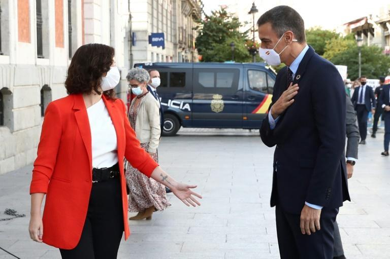 Diaz Ayuso, pictured with Sanchez, has showed herself to have an aggressively confrontational style