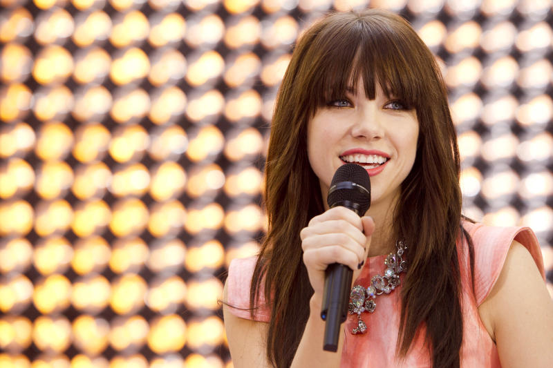 """FILE - This Aug. 23, 2012 file photo shows singer Carly Rae Jepsen performs on NBC's """"Today"""" show in New York. Billboard says the 16-year-old Canadian's infectious pop song about infatuation love topped its """"Songs of Summer"""" chart. The list annually ranks the overall performance of hits songs on the Billboard Hot 100 between Memorial Day and Labor Day. (Photo by Charles Sykes/Invision/AP, file)"""