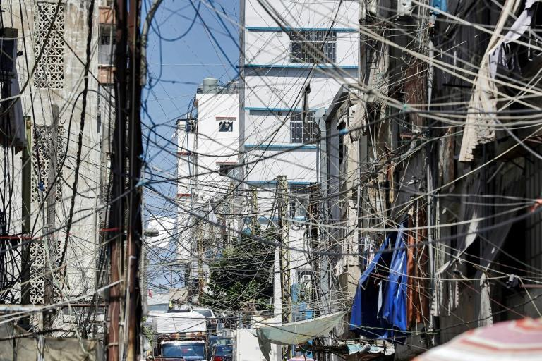 This picture from June 23, 2021 shows a web of raised power lines in a suburb of Lebanon's capital Beirut