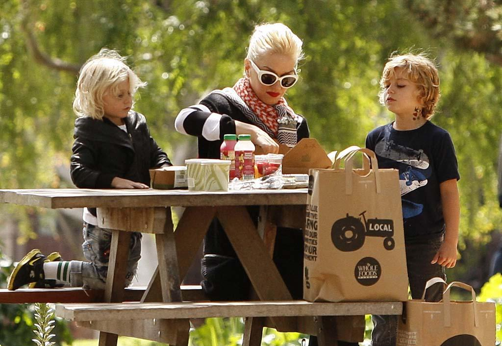 "Rocker Gwen Stefani and her boys Zuma, 3, and Kingston, 5, had a picnic in an L.A. park sans dad Gavin Rossdale. The No Doubt singer has been busy recording a new album with her group and mentoring the ""American Idol"" contestants for an '80s-themed episode that airs Wednesday. (3/31/2012)"