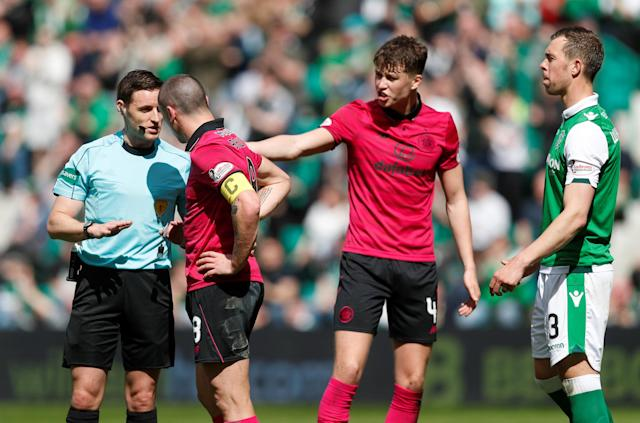 Soccer Football - Scottish Premiership - Hibernian v Celtic - Easter Road, Edinburgh, Britain - April 21, 2018 Referee Steven McLean with Celtic's Scott Brown REUTERS/Russell Cheyne