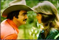 """<p>You can practically see the sparks flying between these two in this still from the film Smokey and the Bandit where they met. It is no surprise that they fell in love and <a href=""""https://www.countryliving.com/life/entertainment/a30188809/sally-field-burt-reynolds-relationship/"""" rel=""""nofollow noopener"""" target=""""_blank"""" data-ylk=""""slk:were together for five years"""" class=""""link rapid-noclick-resp"""">were together for five years</a>. </p>"""