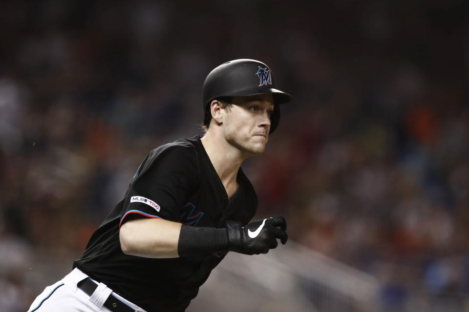 Miami Marlins' Brian Anderson runs to first base after hitting a single during the eight inning of a baseball game against the Atlanta Braves, Saturday, Aug. 10, 2019, in Miami. (AP Photo/Brynn Anderson)