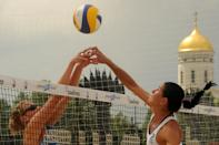 Beach volleyball players take part in a women's Pool Play match during the 2012 FIVB Beach Volleyball World Tour Moscow Grand Slam at the historical Poklonnaya Gora (Victory Park) in Moscow, on June 8, 2012. AFP PHOTO / KIRILL KUDRYAVTSEVKIRILL KUDRYAVTSEV/AFP/GettyImages