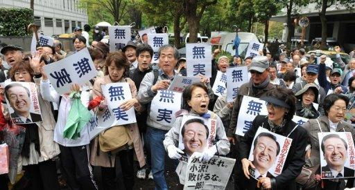 Supporters of former Democratic Party of Japan leader Ichiro Ozawa, seen here gathering at an entrance to the Tokyo District Court, on April 26. Ozawa, one of the most powerful men in Japanese politics was found not guilty of a major funding scandal, paving the way for a possible showdown with the ruling party leadership