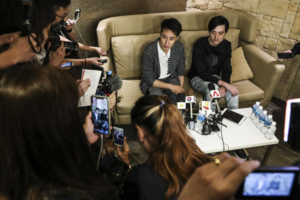 Late actor Aloysius Pang's manager and long-time mentor Dasmond Koh (left), and elder brother Kenny addressing media at a press conference on 24 January, 2019. (PHOTO: AP)