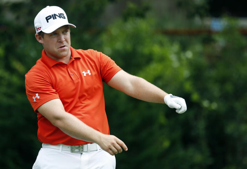 Daniel Summerhays loosens up prior to hitting off the eighth tee during the first round of the Sanderson Farms Championship golf tournament, Thursday, July 18, 2013, in Madison, Miss. (AP Photo/Rogelio V. Solis)