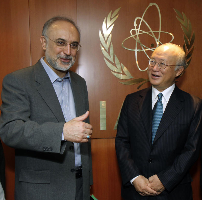 Director General of the International Atomic Energy Agency (IAEA) Yukiya Amano, right, from Japan, welcomes Iranian Foreign Minister Ali Akbar Salehi, left, prior to their talks at the International Center in Vienna, Austria,  Tuesday, July 12, 2011.  (AP Photo/Ronald Zak)
