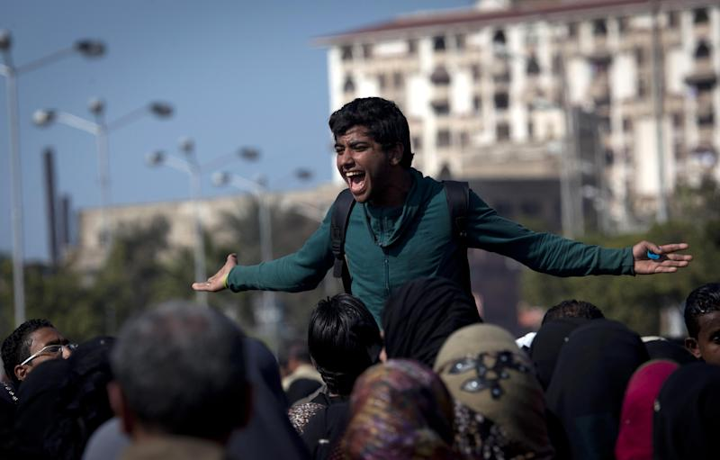 An Egyptian Ultras activist chants anti-President Mohammed Morsi slogans while leading a rally during the fifth day of a general strike, in Port Said, Egypt, Thursday, Feb. 21, 2013. (AP Photo/Nasser Nasser)