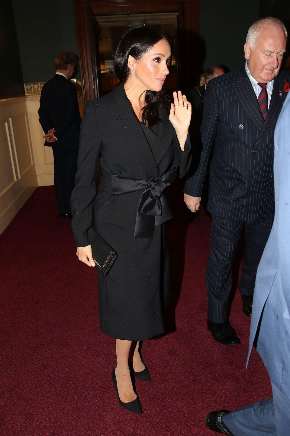 "<p>Meghan attended the Festival of Remembrance in London with Prince Harry wearing<a href=""https://www.townandcountrymag.com/style/fashion-trends/a24749566/meghan-markle-wore-black-stella-mccartney-festival-of-remembrance-photos/"" rel=""nofollow noopener"" target=""_blank"" data-ylk=""slk:a black Stella McCartney coat"" class=""link rapid-noclick-resp""> a black Stella McCartney coat</a> for the somber occasion. The Duchess accessorized with black heels, a small black clutch, and a poppy pin.</p>"